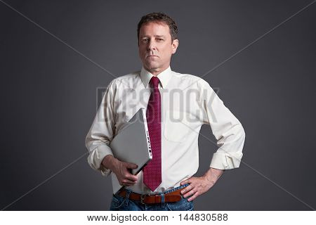 A confident middle age man with a laptop