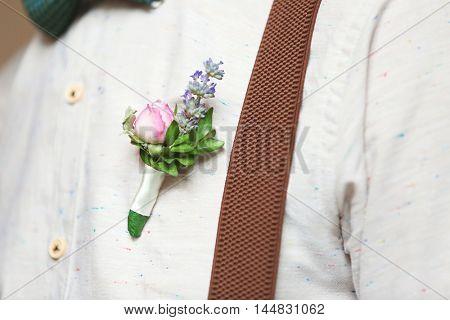 Beautiful boutonniere on groom shirt