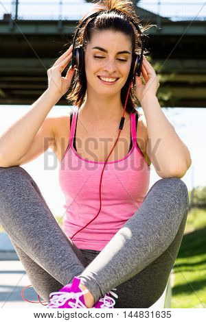 Urban girl listening to some music. city style