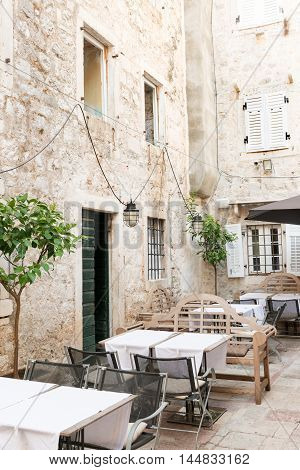 Outside tables of the restaurant in medieval Kotor, Montenegro