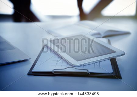 Workplace with tablet and documents on table