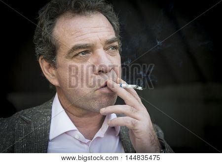 Men smoking sigarette outdoor