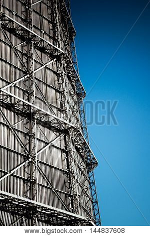 Large factory chimney of slate and clear sky on a sunny day