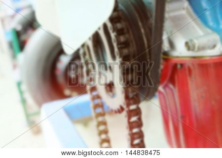 Blurred background chains in the system of the engine. vintage color.