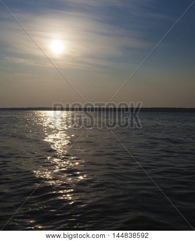 Sun just after it has risen over a lake in Saskatchewan Canada