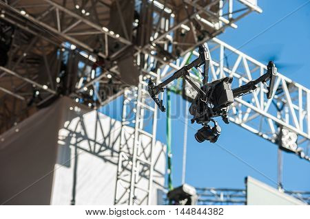 Drone with camera hovers over the stage during a concert