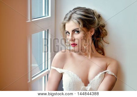 Female Portrait Of Cute Lady In White Bra Indoors. Close Up Beautiful Sexy Model Girl In Elegant Pos