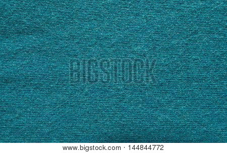 Photo of the Close up blue woollen knitted fabric texture. Angora background