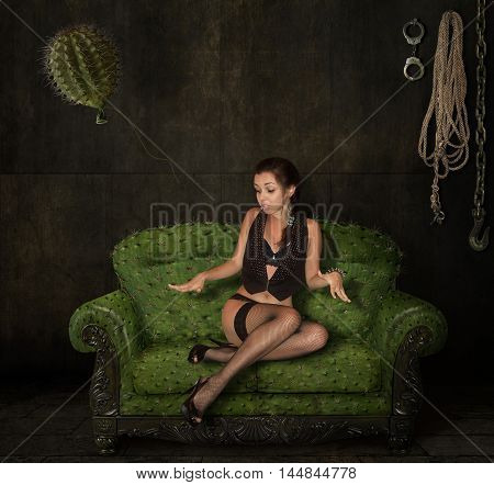 A girl siting on a scratchy sofa. The sofa and balloon looks like a cactus.