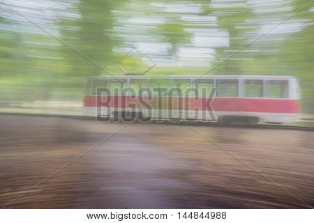 Tram in motion blurred background with a light tone