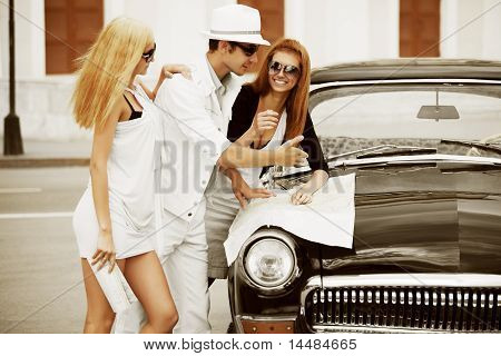 Young Tourists With A Retro Car