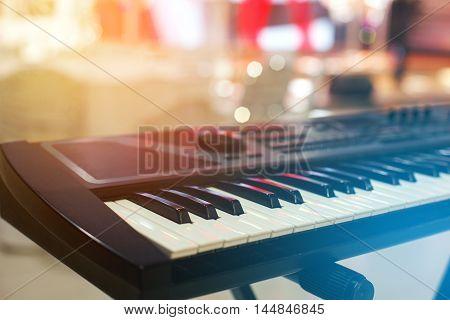 Piano Keyboard synthesizer closeup key, frontal view