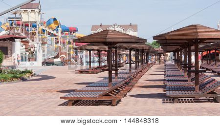 Rows of sun loungers in the water park