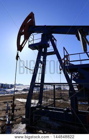 Oil Pumps In A Field In Spring