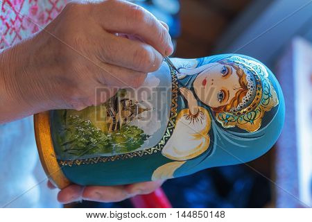 Leningrad region, Podporozhsky District, Russia June 26 2016: Painted handmade wooden dolls matreshka - The village of Upper Mandrogi is a reproduction of a traditional Russian village.