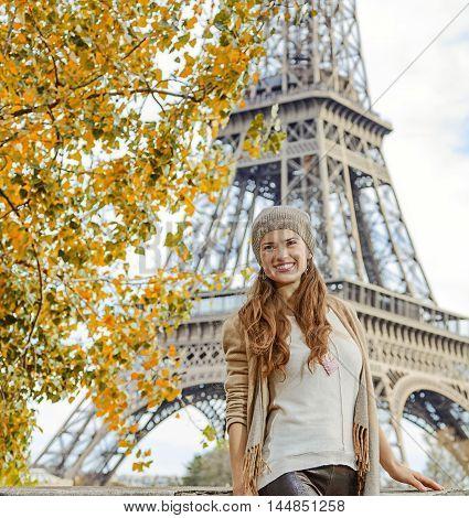 Smiling Elegant Woman Exploring Attractions In Paris, France