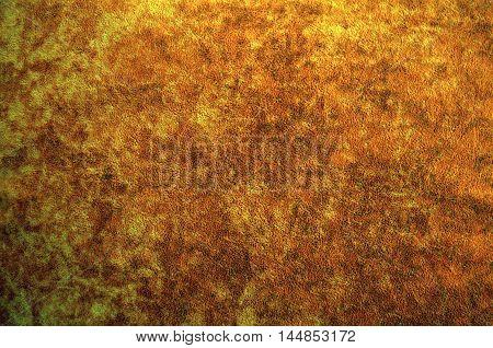 Dark brown suede fabric closeup. Velvet texture.