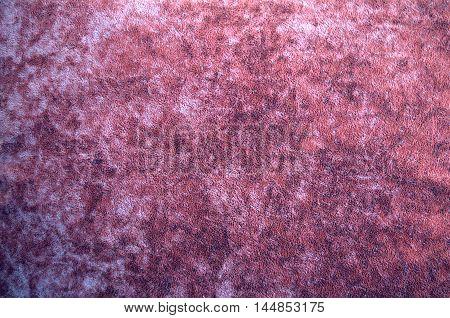 Dark pink suede fabric closeup. Velvet texture.