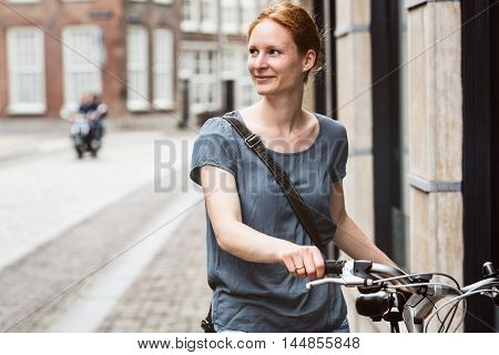 Woman With Bicycle In Old Town