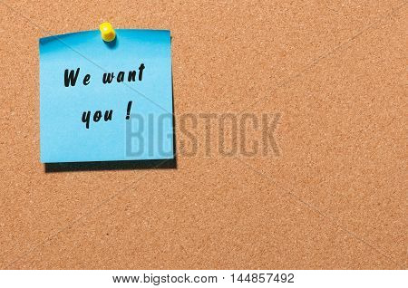 WE WANT YOU message on the sticker pinned at notice cork board. Hiring concept.