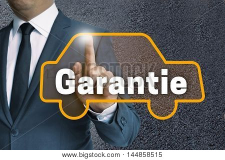 Garantie (in German Warranty) Auto Touchscreen Is Operated By Businessman Concept