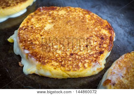 Grilled cheese arepa sandwiches on barbecue grill for summer food background