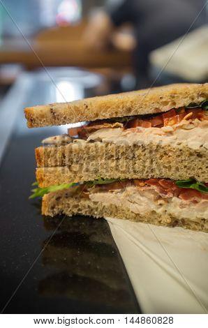 Chicken bacon lettuce and tomato sandwich on whole wheat rye bread