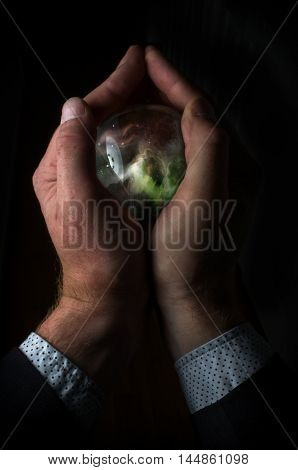 Holding the universe in fortune teller magic crystal ball