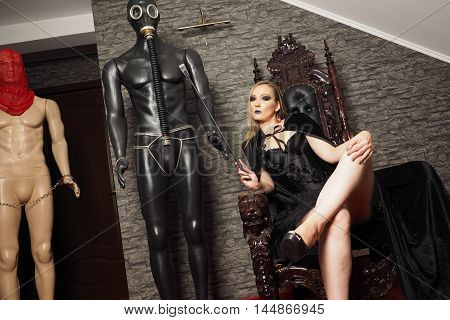 Mistress play with model slave in the room