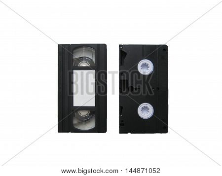 Retro vhs video cassette tape closeup from both sides isolated on white background top view. Old recorder for film and sound.