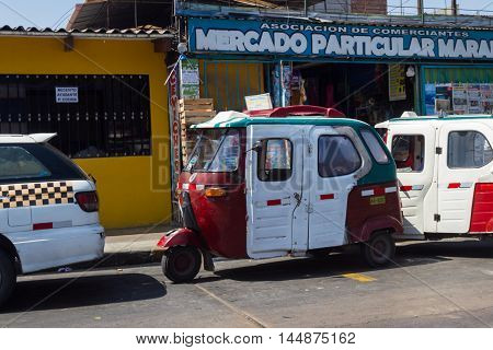 Lima Peru - May 11 : Moto-taxi parked in front of a convenience store Lima. May 11 2016 Lima Peru.