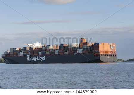 Hamburg, Germany - August 18, 2016: Container ship sails on the Elbe towards Hamburg harbor on August 18, 2016, in the Germany Hamburg
