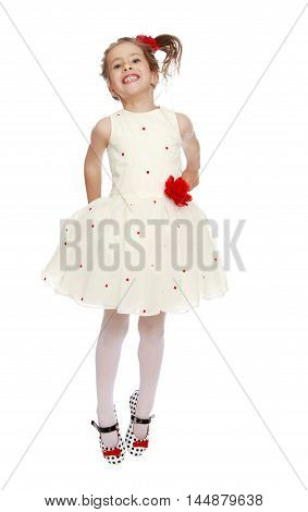 Cute little Princess dressed in a white dress with a red flower at the waist . Girl jumping gesticulating animatedly - Isolated on white background