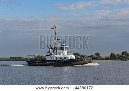 Hamburg, Germany - August 18, 2016: Tugging on the same to haul a container ship on August 18, 2016, in the Germany Hamburg