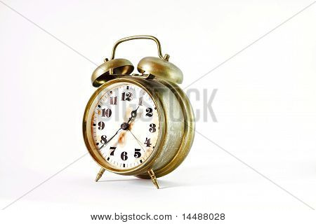Old Vintage Gold Alarm Clock Isolated On White
