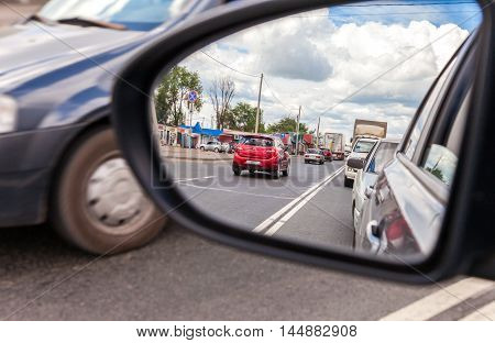 SAMARA REGION, RUSSIA - JUNE 26 2016: Reflection in the rearview mirror of a car
