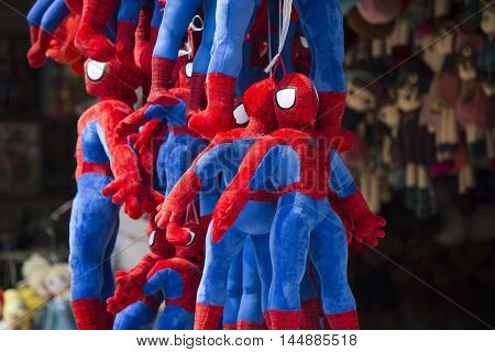 Hanoi, Vietnam - Aug 30, 2016: Colorful made in China blue and red Spider man doll and puppets for sale at Hang Ma old street in Hanoi quarter streets area.
