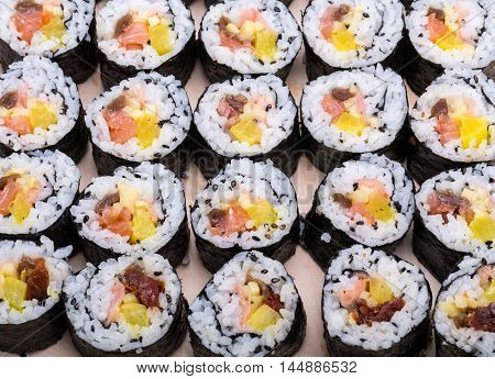 sushi fresh maki rolls isolated on wooden board