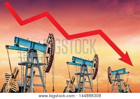 Oil price fall graph illustration. Red arrow. Pump field background.