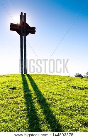 Celtic cross against the blue sky, Celtic oppidum,  Dolni Brezany near Prague, Czech republic