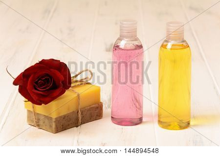 Shower gel soap and rose on a white background