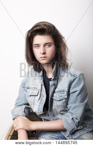 Fashion portrait of a teenager wearing jeans jacket