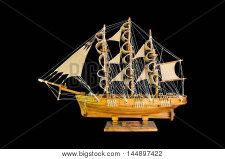 wooden handmade clipper ship for home decoration isolated on black