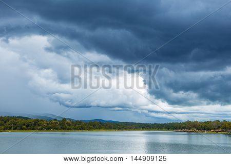 Lake view and dark cloudy blue sky about to rain at Huay Tung Tao Chiang Mai Thailand