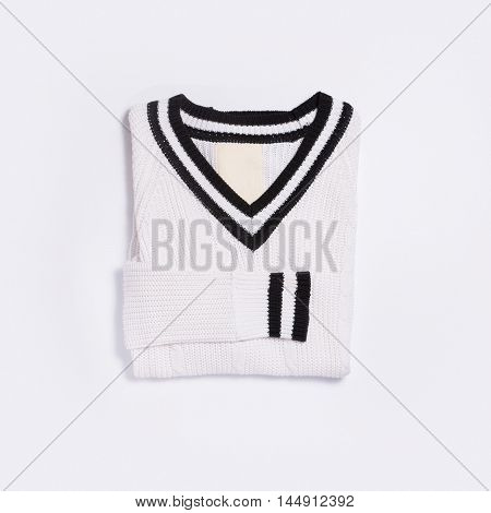 White knitted sweater top view on white