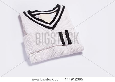 White knitted sweater isolated on white background