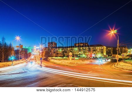 NIZHNY TAGIL RUSSIA - FEBRUARY 13 2016: Light traces of passing cars at the intersection of roads in the city in the winter night