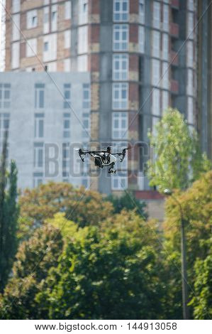 Drone hovers in the air on the background of building under construction