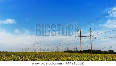 standard overhead power line transmission tower on a sky background.