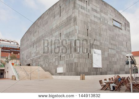 VIENNA, AUSTRIA - JUN 10, 2016: People having rest in outdoor cafe near famous Museum of Modern Art on June 10 2016. MUseum MOderner Kunst in the Museumsquartier has collections of Andy Warhol and Picasso